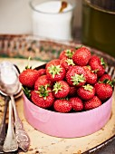 Fresh strawberries in an enamel pot