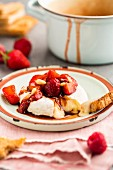 Warm Brie with glazed strawberry and raspberry salsa and pine nuts