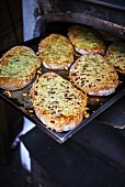 Unleavened bread on a baking tray in an oven