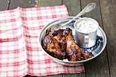 Grilled chicken drumsticks and cucumber raita