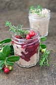 Liver sausage with lingonberries in a screw-top jar