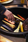 Steak and vegetables on a barbecue