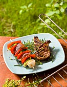 Grilled chops with vegetable skewers