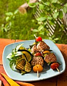 Grilled beef skewers with grilled courgette