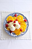 Orange salad with vanilla ice cream and orange cream