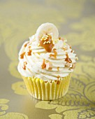 A banoffee cupcake with caramel drizzle