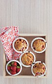 Strawberry muffins on a wooden tray