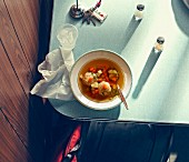 Clear broth with matzo dumplings in a diner (USA)