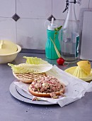 Tuna fish burgers with radishes and spring onions