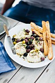 Baked ricotta with an olive salad