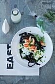 Black tagliatelle with crayfish, peas and tarragon