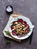 Fried king trumpet mushrooms with beetroot carpaccio