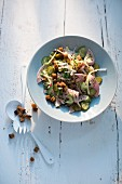 Swiss meat salad with a duo of cucumbers and caraway croutons