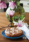 Cinnamon buns with pecan nuts and a butter glaze
