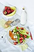 Smoked halibut and balsamic strawberries on a wild garlic salad