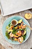 Breaded tofu with peaches and prawns on a bed of lettuce