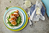 Stuffed chicken breast on a bed of broccoli purée