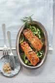 Oven-baked salmon with sesame seeds on braised cucumber medley