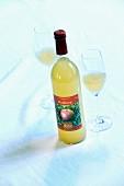 A bottle of 'Boskoop' apple juice and glasses of juice