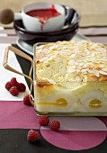 Pear and quark bake with raspberry coulis