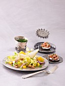 Frisse lettuce and orange salad with shrimps, an orange and dill dressing and pumpernickel bread