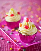 Colourful cupcakes decorated with lime frosting and sweets
