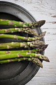 Green asparagus on a pewter plate