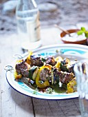 Grilled oriental lamb fillet skewers with mint, peppers and courgettes