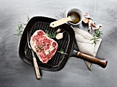 Wagyu ribeye steak with rosemary and garlic in a grill pan