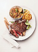Porterhouse steak with roasted vegetable salsa and corn cakes