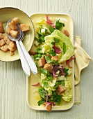 Warm salad with broad beans, peppermint, parsley, apple and croutons