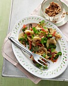 Green papaya salad with pineapple mint, watercress, lime, tomatoes and roasted peanuts
