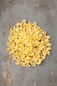 A pile of conchiglie rigate pasta