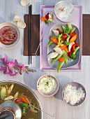 Cooking at the table: Mongolian pot-au-feu with vegetables, chicken and dips