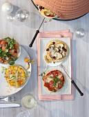 Cooking at the table: various mini pizzas baked in a pizza oven
