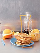 Pancakes with orange fruit salad