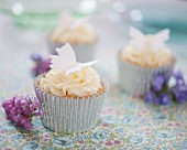 White chocolate cupcakes decorated with fondant butterflies