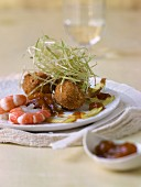 Fish meatballs and prawns with leek straw and pumpkin chutney