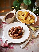 Pigs in blankets with fried potatoes and gravy
