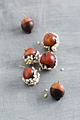 Chocolate-coated gooseberries and chopped almonds