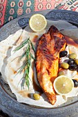 Grilled sturgeon with olives and lemon