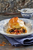 A filo pastry strudel filled with mozzarella and aubergines