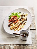 White asparagus with salmon tartare and caper butter