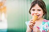 A little girl eating ice cream