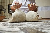 Bread dough being kneaded in a bakery
