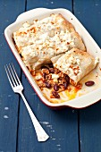 Enchiladas stuffed with beef, tomatoes and kidney beans topped with feta cheese