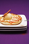 Apple tart with vanilla ice cream and cinnamon