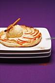 Apple tart with vanilla ice cream and cinnamon