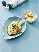 Wild salmon fillet with risotto rice and a courgette medley