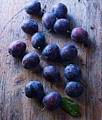 Plums on a rustic wooden surface